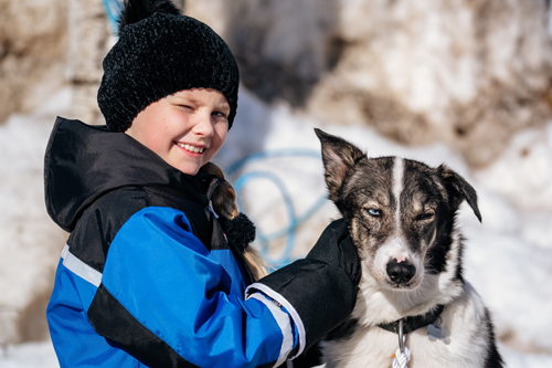 Boy With Dog Sled at Apukka Resort - Credit: Apukka Resort