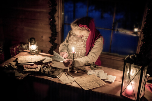 Santa Claus by candlelight - Credit Kimmo Syvari and Visit Finland